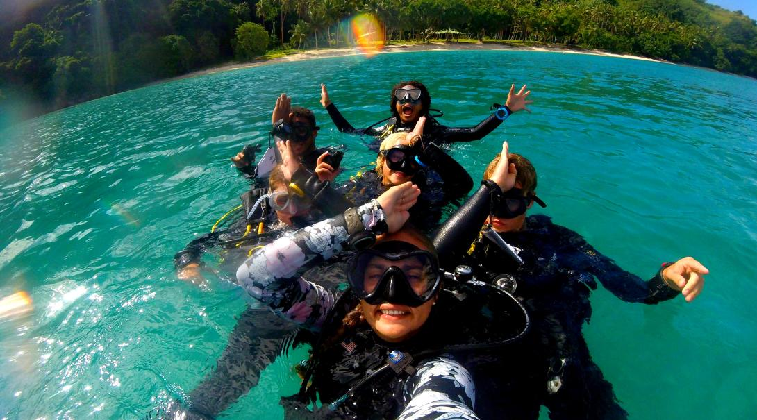 A group of volunteers abroad go diving to collect scientific data on sharks in Fiji.